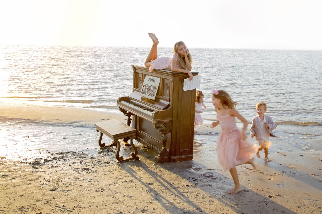 running on the beach hamsptead photographer mayfair holland park london shoreditch islington antique piano beach photography family portrait sunset golden hour ocean children's photography kids session next clothing uk
